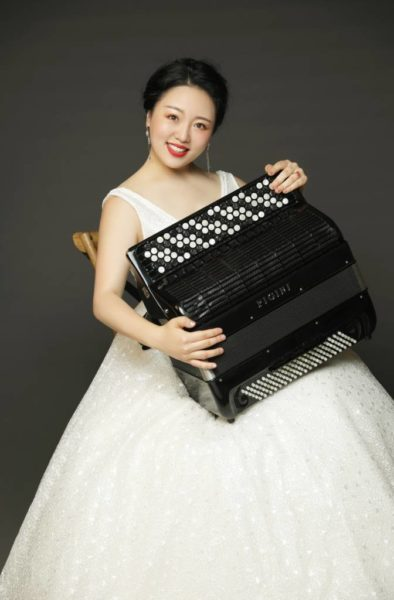 Mingyuan Ruan playing accordion