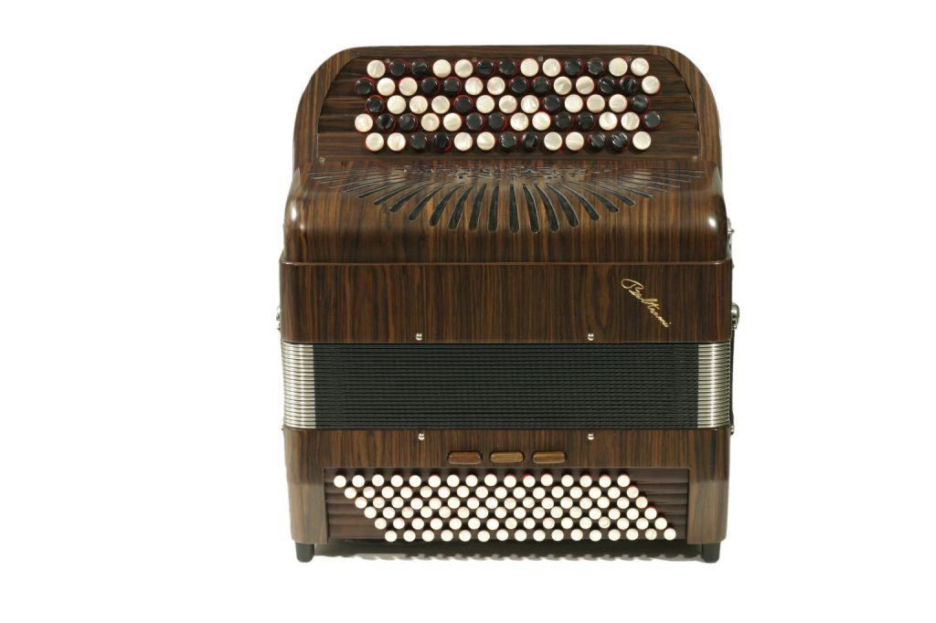 """A professional quality instrument with hand-made reeds. This model is known at the """"La petite"""" and is equipped with three sets of treble reeds and 5 bass sets and comes in various wood finishes as well as black."""