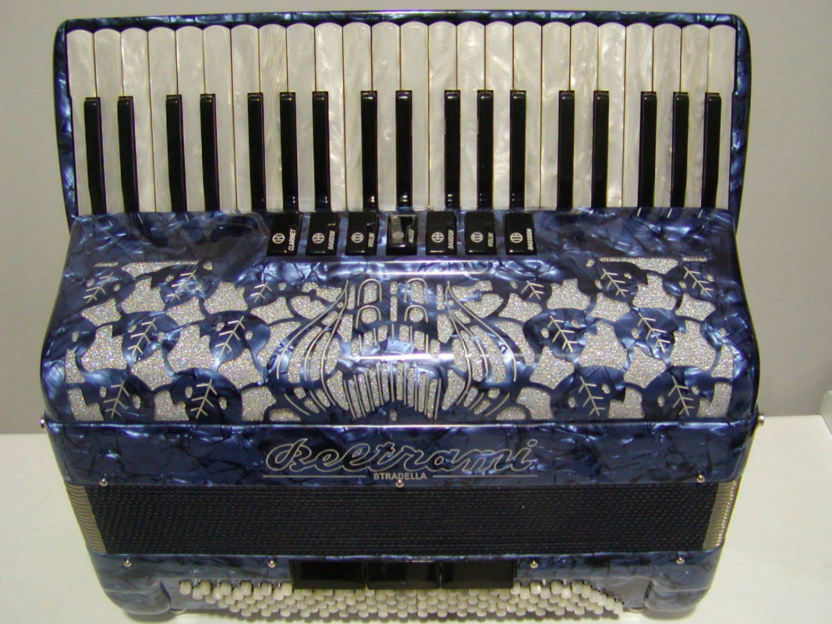 A full-sized model with 3 treble sets and 5 bass sets of hand made reeds as pictured but with 7 bass registers. Available in a full range of colours.
