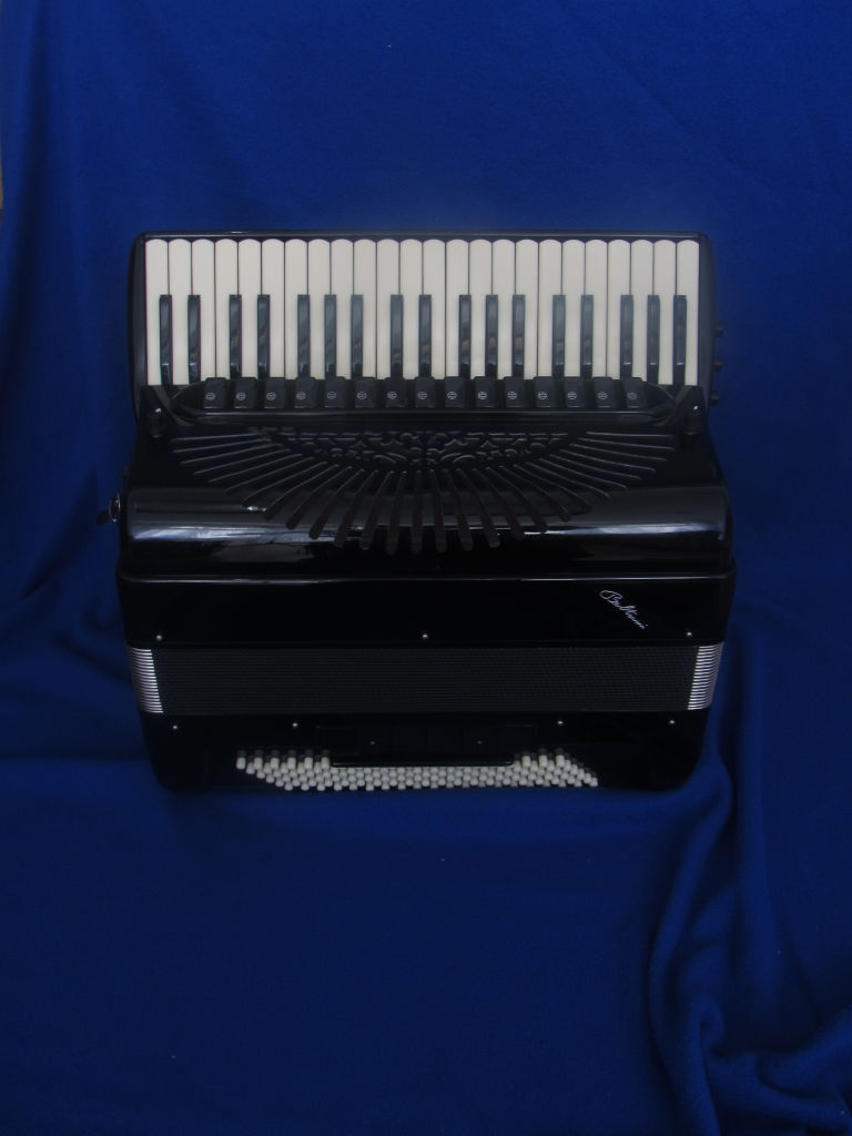 A wonderful 41-key double cassotto professional classical free bass instrument with 4 sets of treble reeds. 2 sets of reeds play when in free bass mode out of the 4 sets of left-hand reeds. 55-note range in the free bass. Also features 4 chin couplers. Hand made reeds.