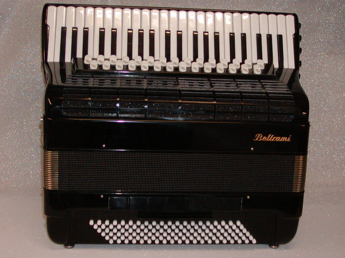 The ultimate Classical Piano accordion. This accordion aims to give a piano accordionist the same range as a button accordionist through it's reed sets. A fabulous 120 bass double cassotto classical free bass instrument with extended keyboard to 45 keys (Also available in a 47 key compact version). 5 sets of right-hand reeds and 6 in the left-hand. The right-hand reed footages are 32'+16' both in cassotto and 8'+8'+4' out of cassotto. This gives this piano accordion the same right-hand reed range as a full-size classical button accordion. (from Eb or E1 in the 32' register to C8 or C#8 in the piccolo register). Customers may opt to have an 8' set of reeds in cassotto rather than the 32' set if they prefer. 120 left-hand buttons of which 58 buttons convert to free bass across 3 sets of reeds. 5 chin couplers. Perfect for more advanced students attending conservatoire and for professionals who want an extended keyboard and everything a 5-treble-voiced piano instrument can offer. Hand made reeds. The arrangement of the left-hand reeds are optional. The customer may decide whether they wish it to be equipped with 8'+8'+2' or with 8'+4'+2' reeds footages.