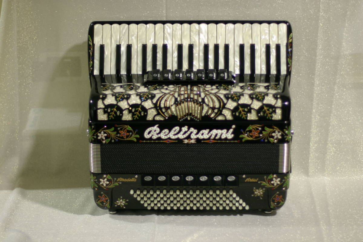 A professional popular-sized model for adults and older children with only 3 treble and 4 bass sets of hand-made reeds one of which is in cassotto. This model can be made to be a purely musette model. featuring only 8 foot reeds. Available in a full range of colours. Black with floral decoration shown.
